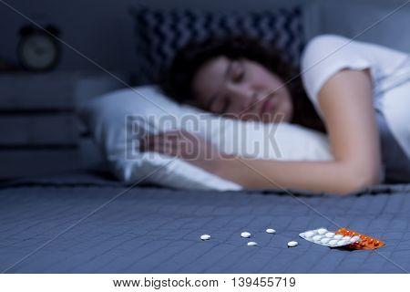 Sleeping Pills On Bed