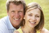 stock photo of close-up middle-aged woman  - Close up of middle aged couple outdoors - JPG