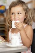 pic of montessori school  - Young Girl Having Tea at Montessori - JPG