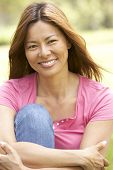 foto of asian woman  - Portrait Of Young Woman In Park - JPG