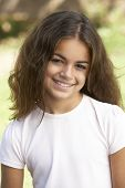 stock photo of ten years old  - Portrait Of Young Girl In Park - JPG