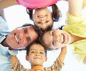 picture of family fun  - Family Group Looking Down Into Camera - JPG