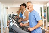 image of senior class  - Senior Man On Running Machine In Gym - JPG