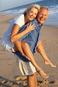 picture of beach holiday  - Senior Couple Enjoying Beach Holiday - JPG