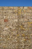 Old Weathered Brick Wall And A Blue Sky. poster