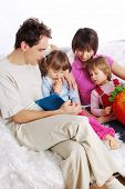 picture of girl reading book  - Happy Family at home reading book - JPG