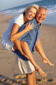 pic of beach holiday  - Senior Couple Enjoying Beach Holiday - JPG