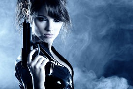 stock photo of raider  - beautiful sexy girl holding gun  - JPG