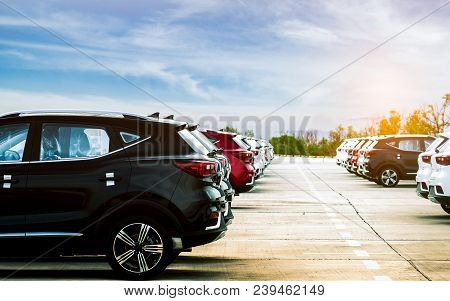 poster of Luxury Black, White And Red New Suv Car Parked On Concrete Parking Area At Factory With Blue Sky And