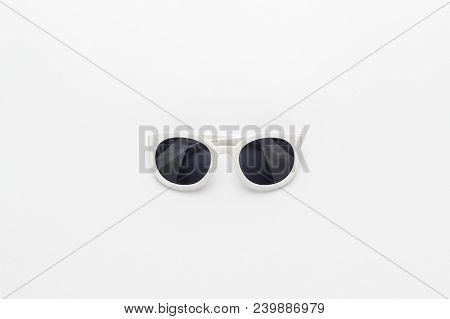 poster of Studio Shot Of White Sunglasses. White Sunglasses Not Isolated. Top View Of White Sunglasses. Centra