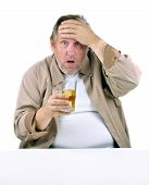 stock photo of horrifying  - horrified man in his 50s sitting at a table with a drink - JPG