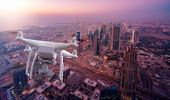 Multicopter Drone flying over the cityscape of Dubai, UAE poster