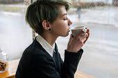 Coffee Or Tea Delight. Woman Enjoying A Cup Of Hot Drink. Girl Treating Herself To A Delicious Hot B poster