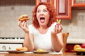 Big Woman Eat Fast Food. Red Hair Fat Girl With Burger, Potato And Fruit. Unhealthy Food Concept Wit poster