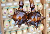 stock photo of hetman  - Wooden spiky souvenir mace on a a blurred background - JPG