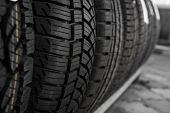 Постер, плакат: Protector Of Automobile Tires A Number Of Automobile Tires Close Up View On Auto Mobile New Wheel