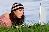 Young Woman Outdoors With Laptop poster