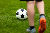 Football Or Soccer Ball At The Kickoff Of A Game. Soccer Free Kick At A Grass Pitch. Young Soccer Pl poster