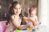Little Girls Playing With Putty At Home poster