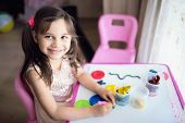 Little Girl Is Playing With Putty At Home poster