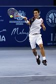 BUKIT JALIL, MALAYSIA- OCT 01: Japan's Kei Nishikori hits a forehand return in this Malaysian Open s