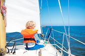 Kids Sail On Yacht In Sea. Child Sailing On Boat. poster