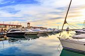 Luxury Yachts And Motor Boats At Sunset. Sailing Boats Docked At Pier In Marina In Sunshine, Blue Wa poster
