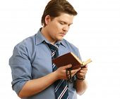 foto of tasbih  - Young businessman with beads reading koran isolated - JPG