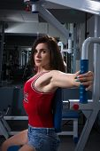 Sports Woman Doing Exercises On Power Training Apparatus In The Gym. In Stoke.the Young Girl Doing E poster