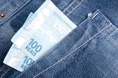 image of brazilian money  - Brazilian money in the pocket of his jeans - JPG