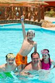 picture of swimming pool family  - Kids and father in pool - JPG