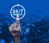 Hand Pressing Button 24 Hours Service Icon Over Modern City Tower, Street And Expressway, Full Time  poster
