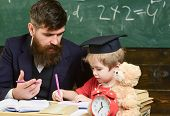 Elementary Education. Teacher In Formal Wear And Pupil In Mortarboard In Classroom, Chalkboard On Ba poster