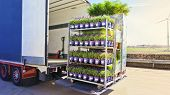 There Is A Loading To The Truck Trailer  .open Delivery Truck Loaded With Pot Plants Pallets . poster