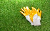 Protective Gloves Lie On The Artificial Grass Lawn poster