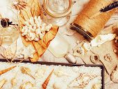 A Lot Of Sea Theme In Mess Like Shells, Candles, Perfume, Girl Stuff On Linen, Pretty Textured Post  poster
