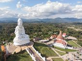 Aerial View Of Wat Huay Pla Kang Famous Place Attractions For Tourist In Chiang Rai .guan Im Statue  poster