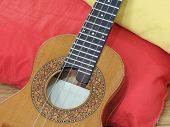 Close-up Of A Cavaquinho, A Brazilian String Musical Instrument, On Two Pillows. This Instrument Is  poster
