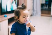 A Little Girl Yourself Holding The Mask Of The Nebulizer, Making Inhalation poster