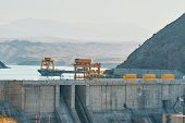 Dam In The Mountains. A Way To Generate Electricity Without Polluting The Environment. poster