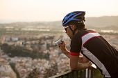 Adventure Male Vloger Using Action Camera Outdoor. A Male Cyclist Blogger Shoots Video On An Action  poster