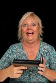 Mature Blonde Woman With Cell Phone And A Handgun (5)