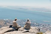 Adult European Couple In Hats Admiring The View Of Cape Town And The Ocean From The Top Of Table Mou poster