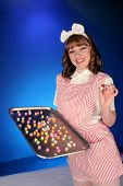 stock photo of striper  - teenage candy striper passes out hearts on a silver tray - JPG