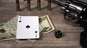 A Dangerous Game For Money. On A Wooden Table Are A Pistol With Cartridges, Cash Dollars, A Deck Of  poster