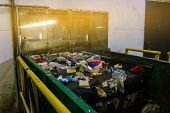 Recycling. Sorting Garbage On A Conveyor Belt. The Technological Process At The Waste Recycling Plan poster