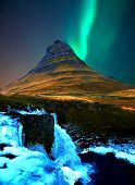 Iceland Famous Mountain Kirkjufell With Aurora Borealis Northern Light With Waterfall In Winter At N poster