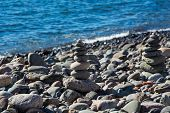 Stones On The Coast. Pebble Pyramids. Strip Of The Ocean And The Coast Of The Canary Islands. poster