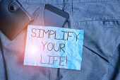 Text Sign Showing Simplify Your Life. Conceptual Photo Focused On Important And Let Someone Else Wor poster