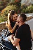 Portrait Of Beautiful Young Couple On A Motorcycle. Attractive Young Woman With Handsome Young Man O poster